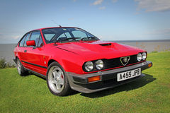 Vintage alfa romeo. Photo of a red vintage alfa romeo sports car showing at whitstable car show in kent on 17th august 2014.photo ideal for performance cars Stock Photography