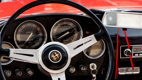VINTAGE ALFAROMEO dashboard AND wheel Stock Image