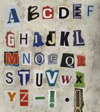 Vintage alphabet on concrete Royalty Free Stock Photography