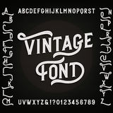Vintage alphabet font with alternates. Letters, numbers and symbols. Stock Image
