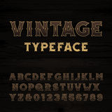 Vintage alphabet font. Bold letters and numbers. Stock Photos