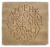 Vintage alphabet letters and numbers kraft. Vintage font, letters and numbers in retro style drawing on kraft background Royalty Free Illustration