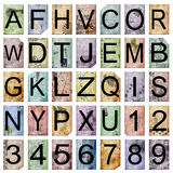 Vintage alphabet and numbers. Alphabet and numbers on a vintage paper Stock Image