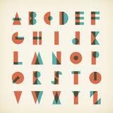 Vintage alphabet typography font on textured paper Stock Image