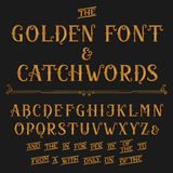 Vintage alphabet vector font with catchwords. Golden ornate letters and catchwords. Royalty Free Stock Photos