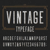 Vintage alphabet vector font with distressed overlay texture. Vintage typeface with scratched overlay texture. Type letters, numbers and symbols on a dark stock illustration
