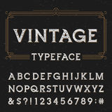 Vintage alphabet vector font with distressed overlay texture. Royalty Free Stock Photo