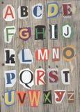 Vintage alphabet on wood Royalty Free Stock Photos