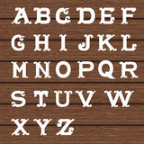 Vintage alphabet on wooden background Stock Images