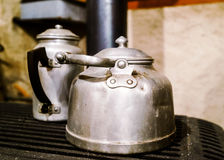 Vintage aluminium teapots in old house Stock Photos