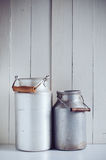 Vintage aluminum milk cans Stock Photography