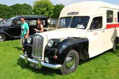 Vintage ambulance. Picture taken in NOTTINGHAM, UK. JUNE 1, 2014: Visitors admire a vintage ambulance van displayed at the vintage motor show in Nottingham Stock Image
