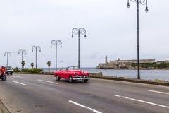 Vintage American car, Havana, Cuba. Vintage American car driving along the Malecon, Havana, Cuba Stock Images