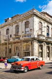 Vintage american car next to an crumbling old building in Havana Royalty Free Stock Photography