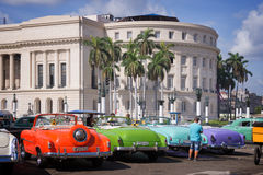 Vintage american cars parked in front of the Capitolio in Old Havana Stock Photography