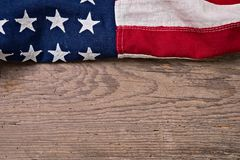 Vintage American Flag Border. Ing a worn out weathered wooden plank with space for text Stock Photo