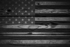 Vintage American Flag painted on an aged, weathered rustic wooden Background. Stock Photography