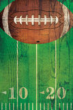 Vintage American Football Ball Field Background. An American football and field painted over a textured hardwood floor background Royalty Free Stock Image