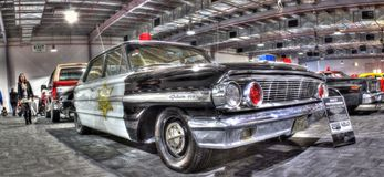 Vintage American police car. Vintage American 1960s Ford Galaxie black and white cop car on display at the 2016 Meguiar's Motorex held in Melbourne, Australia Royalty Free Stock Image