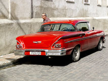 Free Vintage American Red Car In A Paved Cuban Street. Royalty Free Stock Photo - 50147645