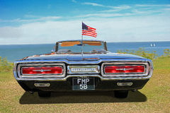 Vintage american thunderbird. Photo of a vintage american thunderbird car flying the american flag on display at whitstable car show during summer of 2016 stock images