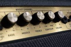 Vintage amplifier five knobs diagonal closeup royalty free stock photo