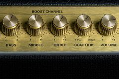 Vintage amplifier five knobs horizontal closeup, music recording studio equipment, bottom copy space. Vintage amplifier five knobs horizontal closeup, music royalty free stock photo