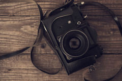 Vintage analog camera on wooden background. top view Stock Photo