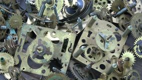 Vintage analog clock brass gears and cogs background stock footage