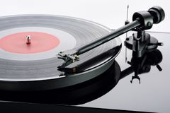 Tonearm with cartridge of turntable with record. Stock Photos