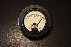 Vintage Analog meter with dial near maximum stock image