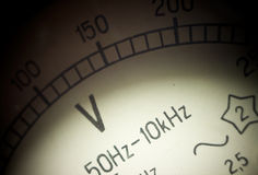 Vintage analog voltmeter dial. Stock Photos