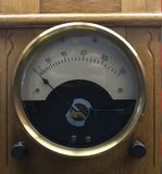 Vintage analogue ammeter made of metal on a wooden work bench.  Stock Image