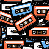 Vintage analogue cassettes. Vintage analogue music recordable cassettes. Seamless background Royalty Free Stock Photo