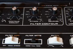 Vintage analogue music synthesizer control panel closeup in shallow focus.  Royalty Free Stock Photography