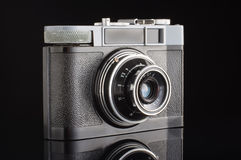 Vintage analogue photo camera isolated with reflection on the black background Royalty Free Stock Photos