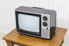 Vintage Analogue Television on Table. Vintage analogue television on old wood table stock images