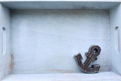 Vintage anchor decoration. Vintage anchor in white wooden box Royalty Free Stock Images