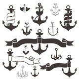 Vintage anchor with ribbon banners. Hand drawn elements Stock Image