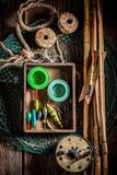 Vintage angler equipment with rods, net and fishing flies. Retro style royalty free stock photo