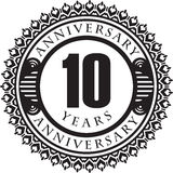 Vintage anniversary 10 years round emblem. Retro styled vector b. Ackground in black tones Stock Photography