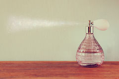 Vintage antigue perfume bottles, on wooden table. retro filtered image.  Stock Photo