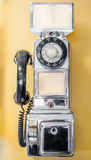 Vintage, antiquado, retro, a fichas, telefone do pagamento do passado fotografia de stock royalty free