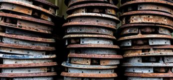 Vintage antique automotive brake shoes connected to backing plates in a pile. At a wrecking yard Stock Image