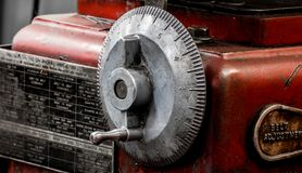 Vintage antique automotive machine shop honing machine dial indicator wheel and hand crank. With size chart royalty free stock photo