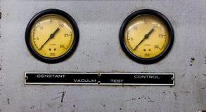 Vintage antique automotive machine shop vacuum gauges on a silver sheet metal plate royalty free stock images