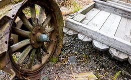 Vintage antique automotive tractor wheel covered in rust royalty free stock image