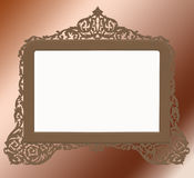 Vintage antique brass frame. A cutout vintage brass frame in an antique looking filigree design on a graded background Royalty Free Stock Images