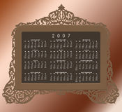 Vintage antique brass frame with 2007 calendar. A cutout vintage brass frame in an antique looking filigree design on a graded background with a 2007 calendar in Stock Photo