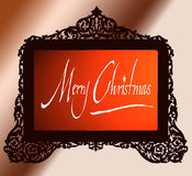 Vintage antique brass frame with Merry Christmas. A cutout vintage brass frame in an antique looking filigree design on a graded background and merry christmas Royalty Free Stock Photo